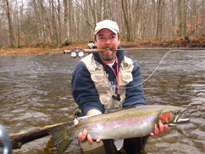 Photo of a person holding a steelhead trout